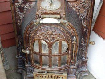 DS Antiquités - poêle en fonte - Poêle