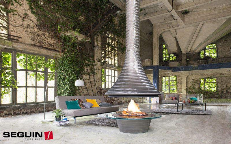 Seguin Duteriez Central fireplace Fireplaces Fireplace Dining room | Design Contemporary