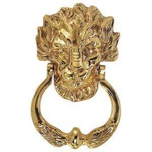 FERRURES ET PATINES - heurtoir de porte lion en bronze - Paracolpi